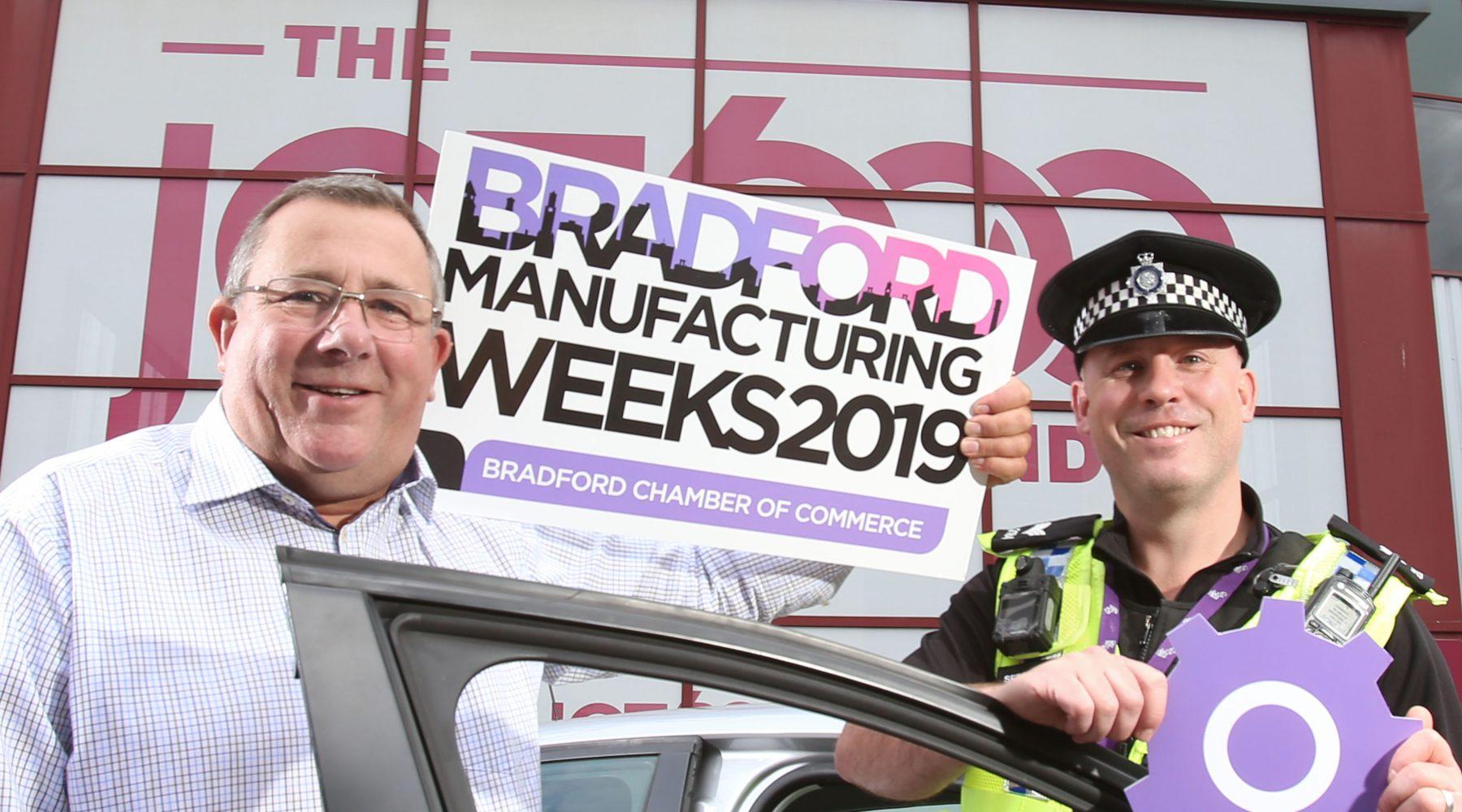 Christeyns UK MD Nick Garthwaite (left) with Sergeant of West Yorkshire Police Jamie Wilkinson (right)